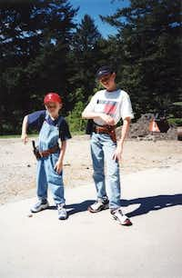 Jonathan Crews (right) and his younger brother show off their new guns during a visit to Montana to see their grandfather.((Crews family))