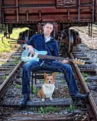 "Jonathan Crews poses with his guitar and his Corgi, Ulysses. His father, John Crews, described him as a ""Renaissance man"" who was well-read and sought adventure.((Crews family))"