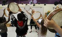 Karen Becker (center) uses tambourines in a mirroring exercise in her third-grade music class at Garner Fine Arts Academy in Grand Prairie. the campus is located near housing for GPISD Superintendent Susan Simpson Hull. (DMN file photo)