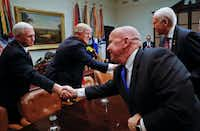 President Donald Trump and Vice President Mike Pence greet Rep. Kevin Brady (front), R-The Woodlands, and Utah Sen. Orrin Hatch during a meeting in the Roosevelt Room of the White House. (Pablo Martinez Monsivais/The Associated Press)
