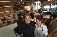 Oddfellows owner Amy Cowan (left) and chef Anastacia Quinones organized efforts to bring box lunches to DFW International Airport to feed the families and supporters of immigrants detained as a result of the Trump administration's temporary travel ban.((Louis DeLuca/Staff Photographer))
