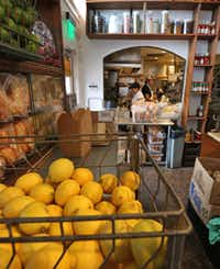Oddfellows' kitchen brims with activity and fresh ingredients.((Louis DeLuca/Staff Photographer))