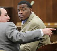 In this Jan. 23, 2014, file photo, former Baylor football player Tevin Elliott waits with a unidentified lawyer in a McLennan county courtroom in Waco, Texas. ((AP))