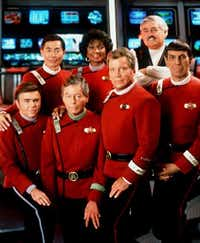Front row, from left: Walter Koenig as Chekov, DeForest Kelley as Dr. McCoy, William Shatner as Admiral Kirk and Leonard Nimoy as Mr. Spock; back row, from left: George Takei as Zulu, Nichelle Nichols as Ohura and James Doohan as engineer Scotty. ((Agence France-Presse) )