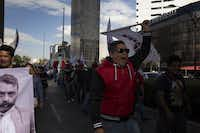 "Demonstrators protested against President Donald Trump in Mexico City on Jan. 20, angered by his assertions of weak borders and lopsided trade deals in his ""America First"" inauguration speech. (Yael Martinez/Bloomberg News)asdfadf"