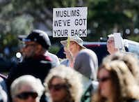 A woman holds up a sign during a Texas Muslim Capitol Day rally in Austin on Tuesday, January 31, 2017. (Vernon Bryant/The Dallas Morning News)(Staff Photographer)