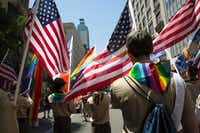 A group of Boy Scouts lead the Pride parade in New York, June 29, 2014. The Boy Scouts announced on Monday Jan. 30, 2017 that it will welcome transgender boys to camp, hike and earn merit badges alongside their peers. (James Estrin/The New York Times)(NYT)