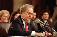 In this Sept. 16, 1987 file photo, U.S. Supreme Court nominee Robert H. Bork testifies before the Senate Judiciary Committee during his confirmation hearings on Capitol Hill. (AP Photo/Charles Tasnadi) (AP)