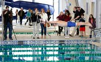 McKinney Mayor Brian Loughmiller takes a ceremonious jump in the pool to swim a lap shortly after the ribbon cutting at the Apex Centre.  (Vernon Bryant/The Dallas Morning News)Staff Photographer