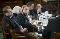 <p>Sen. Sylvia Garcia, D-Houston, listens to people testify on the issue at the Texas Capitol.</p>((Kelly West/Austin American-Statesman))