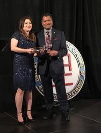 <br><b>Rosa Oh, immediate past chair of the Greater Dallas Asian American Chamber of Commerce, receives a gift from new chairman Kamal Kaushal. (Deborah Fleck)</b><div><br></div>