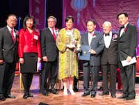 Amy Hofland (center), executive director of the Crow Collection, is presented the Global Vision Award during the Greater Dallas Taiwanese Chamber of Commerce's annual Lunar New Year Gala. (Deborah Fleck)