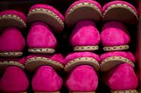 Hot pink Sabahs at the Sabah House on Routh Street in Dallas. The slippers have rubber soles for durability. (Allison V. Smith/Special Contributor)
