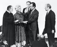 1976: George H.W. Bush (second from right) is sworn in as CIA diretor by Associate Supreme Court Justice Potter Stewart in Washington, D.C., as his wife, Barbara Bush, CIA's vice director Vernon Walters (background) and President Gerald Ford watch.(AFP/Getty Images)