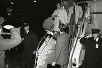 1981: While sharpshooters watched from the hangar roof, Vice President Bush arrives at Andrews Air Force Base from Texas after the assassination attempt on President Reagan.(The White House/George Bush Presidential Library)