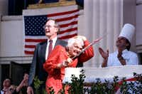 1986: Vice President George Bush laughs as his wife, Barbara, offers a startled reaction to a ceremonial fly-over by jets during cake-cutting ceremonies celebrating the Texas sesquicentennial at Fair Park in Dallas.(Ken Geiger/Staff Photographer)