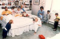 1987: Vice President George H.W. Bush and his wife Barbara are joined in their bedroom by six of their grandchildren at the family retreat in Kennebunkport, Maine. The spontaneous moment, shot by George H.W. Bush's personal photographer David Valdez, for use in <i>LIFE Magazine</i>, became an iconic photos of the Bush family. Valdez later became director of the White House photo office under Bush in 1988.(David Valdez)
