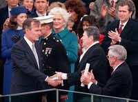 1989: Outgoing President Ronald Reagan congratulates newly inaugurated President George H.W. Bush as first lady Barbara Bush (center), George W. Bush (top right) and others applaud during the swearing-in ceremony.(Joe Burbank/Orlando Sentinel)