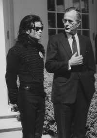 "1990: President George H. W. Bush meets with singer Michael Jackson at the White House. Jackson was in Washington, D.C., to be presented with the ""Entertainer of the Decade"" award by the Friends of the Capital Children's Museum.(Barry Thumma/The Associated Press)"