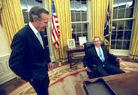 2001: President George W. Bush talks to his father, former President George H.W. Bush, as he sits at his desk in the Oval Office for the first time after the younger Bush's inauguration.(Eric Draper/The White House)