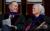 2008: Former President George H.W. Bush and Barbara Bush listen as their son, President George W. Bush, delivers the commencement address during the Texas A&M University graduation ceremony in College Station.(Saul Loeb/AFP/Getty Images)