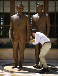 2013: Sculptor Chas Fagan of Charlotte applies wax to the 8-foot bronze statues he created of former Presidents George W. Bush (left) and George H.W. Bush in the courtyard of the George W. Bush Presidential Center in University Park.(Tom Fox/Staff Photographer)