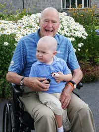 2013: President George H. W. Bush poses for a photo with his young friend Patrick (last name withheld at family's request), 2, in Kennebunkport, Maine. The former president joined members of his Secret Service detail in shaving his head to show solidarity for Patrick, who is the son of one of the agents. The child was undergoing treatment for leukemia and losing his hair as a result.(Office of George Bush)