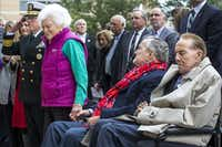 "2016: Barbara Bush stands beside former President George H.W. Bush (seated) and former Sen. Bob Dole during the playing of ""Taps"" during a commemoration of the 75th anniversary of Pearl Harbor at the George Bush Presidential Library in College Station, Texas.(Smiley N. Pool/Staff Photographer)"