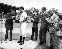 1948: Baseball legend Babe Ruth (left) presents his papers to Yale University, received by Yale baseball team captain George Bush, who graduated with a degree in economics that year.(George Bush Presidential Library)