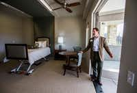 """<span style=""""font-weight: normal;"""">Peter Lynch, executive director of Presbyterian Communities and Services, shows off the balcony inside a patient room at the new T. Boone Pickens Hospice and Palliative Care Center on Tuesday.. (Ashley Landis/The Dallas Morning News)</span>(Staff Photographer)"""