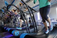 A group exercise class uses treadmills at BEYOND 500 fitness studios, on Tuesday, Nov. 25, 2014 in Dallas. (Ben Torres/Special Contributor)