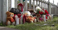 A memorial has been set up at the site where Reed was killed.<br>(KXAS-TV)