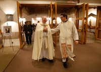 Bishop Edward Burns (left), the new bishop of Dallas, and Rev. Joshua Whitfield walk out of the sanctuary after the Advent Holy Hour mass at Saint Rita Catholic Community in Dallas, Tuesday, Dec. 13, 2016. (Jae S. Lee/The Dallas Morning News)(Staff Photographer)
