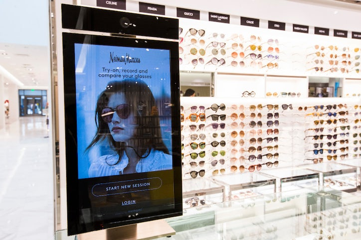 5491094d08f6 A memory mirror by Memomi helps customers choose sunglasses inside a new Neiman  Marcus store on Wednesday