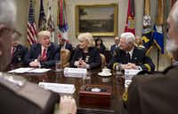 President Donald Trump spoke alongside Sheriff Carolyn Bunny Welsh of Chester County, Pa., and Sheriff Harold Eavenson of Rockwall County, Texas, during a meeting with county sheriffs in the Roosevelt Room of the White House on Feb. 7.((Agence France-Presse))