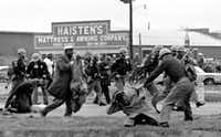"State troopers used clubs against participants of a civil rights voting march in Selma, Ala., on March 7, 1965. At foreground right, John Lewis, chairman of the Student Nonviolent Coordinating Committee and a future congressman, is beaten by a state trooper. The day, which became known as ""Bloody Sunday,"" is widely credited for galvanizing the nation's leaders and ultimately yielded passage of the Voting Rights Act of 1965. (File Photo/The Associated Press)"