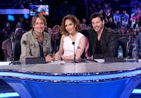 "In this image released by Fox, judges, from left, Keith Urban, Jennifer Lopez and Harry Connick Jr. appear on the set of ""American Idol,"" in Los Angeles. (Ray Mickshaw/FOX via AP)"