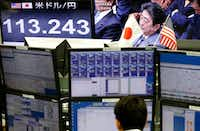 FILE - In this Feb. 1, 2017, file photo, a money trader watches computer screens with the day's exchange rate between Japanese yen and the U.S. dollar as TV shows Japanese Prime Minister Shinzo Abe attending a parliament session at a foreign exchange brokerage in Tokyo. When they meet on Friday, Feb. 10, 2017 in Washington, Abe and U.S. President Donald Trump will be tackling issues where the two sides are unlikely to see eye-to-eye, based on Trump's recent comments. (AP Photo/Shizuo Kambayashi, File)(AP)