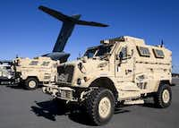 In this Nov. 28, 2007, file photo, mine-resistant, ambush-protected vehicles (MRAP), produced by Navistar International, are loaded onto an airplane at the Charleston Air Force Base in North Charleston, S.C.(AP Photos/Alice Keeney, File)(AP)