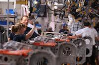Workers assemble diesel engines at the Cummins, Inc., Jamestown Engine Plant near Jamestown, N.Y.(BLOOMBERG NEWS)