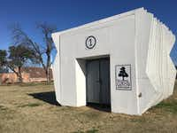 <p>This is one of the white cube-shaped art galleries on the field across from Sam Tasby Middle School in the Vickery Meadow neighborhood.</p>((Julieta Chiquillo/Staff))