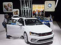 Attendees look at the Volkswagen Jetta during the 2017 North American International Auto Show in Detroit. (AFP/Getty Images)
