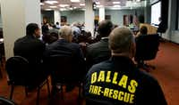 People sit in the gallery as the Dallas Police & Fire Pension System board of trustees meet in Dallas, Thursday, Dec. 8, 2016. The board is expected to decide whether to stop lump sum withdrawals from the ailing fund. (AP Photo/LM Otero)(AP)