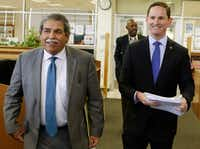 DISD Superintendent Dr. Michael Hinojosa, left, and Dallas County Judge Clay Jenkins arrive at W. H. Adamson High School for a news conference. (David Woo/The Dallas Morning News)(20031725A)