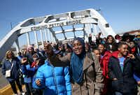 School kids walk across the Edmund Pettus Bridge as they visit historic sites from the Selma to Montgomery civil rights march on March 6, 2015 in Selma, Alabama. (Justin Sullivan/Getty Images)