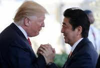 WASHINGTON, DC - FEBRUARY 10:  President Donald Trump (L) greets Japanese Prime Minister Shinzo Abe as he arrives at the White House on February 10, 2017 in Washington, DC. The two will hold a bilateral meeting and press conference today at the White House.  (Photo by Mario Tama/Getty Images)