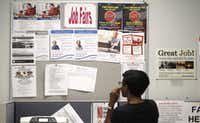 A job seeker looks at a bulletin at the Texas Workforce Commission's Workforce Solutions of Greater Dallas job resource center. (AP Photo/LM Otero) (AP)