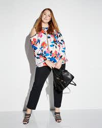 Vince Camuto bell-sleeve cold shoulder top and the French Connection Devin suede-panel Satchel Bag.  For launch of Neiman Marcus Last Call new women's plus-size departments in five Last Call stores on Feb. 18, 2017.(Neiman Marcus)