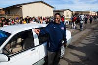 Teacher's aide Kevin MaBone was surprised with a car during a presentation by students and teachers outside Wilkinson Middle School in Mesquite. (Ashley Landis/Staff Photographer)