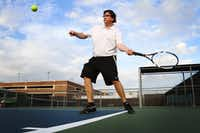 FILE PHOTO: Michael Fowler prepares to send a ball back to his good friend Tylir Jimenez, (not pictured) tennis coach at Highland Park High School, on Aug. 27, 2012 at Seay Tennis Center in Dallas.(Ben Torres/ Special Contributor)